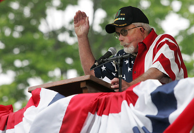 Kyle Grillot - kgrillot@shawmedia.com   Vietnam veteran John Hansen gives a speech before the start of the Woodstock Memorial Day parade at Woodstock Square Monday, May 27, 2013.