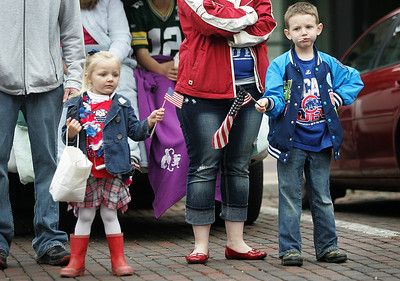 Kyle Grillot - kgrillot@shawmedia.com   Lydia Weidner, 3, and Carter Larson watch passing cars during during the Woodstock Memorial Day parade at Woodstock Square Monday, May 27, 2013.
