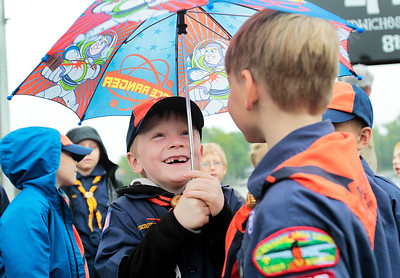 Kyle Grillot - kgrillot@shawmedia.com   Tiger Scouts from pack 455 den 8 gather in the parking lot of Epic Deli before the start of the Johnsburg Memorial Day parade Monday, May 27, 2013.