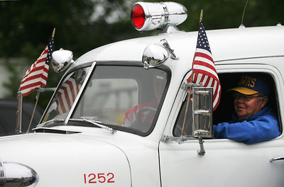 Kyle Grillot - kgrillot@shawmedia.com   Dick Seaborn waits inside the Johnsburg rescue squad before the start of the Johnsburg Memorial Day parade Monday, May 27, 2013.