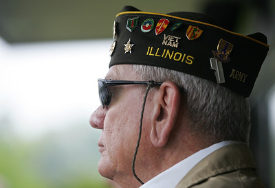 Kyle Grillot - kgrillot@shawmedia.com   John Regner listens as a song is played before the start of the Johnsburg Memorial Day parade Monday, May 27, 2013.