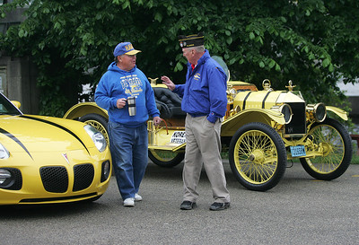 Kyle Grillot - kgrillot@shawmedia.com   Dick Seaborn and John Huemann chat around parade vehicles in the parking lot of Epic Deli before the start of the Johnsburg Memorial Day parade Monday, May 27, 2013.