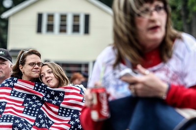 Sarah Nader - snader@shawmedia.com Mia Correra (left) of McHenry and her daughter, Stacy, 11, bundle while attending the Memorial Day Ceremony at Veteran's Park in McHenry on Monday, May 27, 2013.