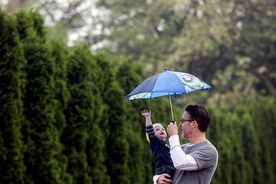 Sarah Nader - snader@shawmedia.com Bob Telmanik of Crystal Lake holds his son, Spencer, 1, while they watched the Crystal Lake Memorial Day Parade on Monday, May 27, 2013.