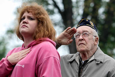 Sarah Nader - snader@shawmedia.com Veteran Jim Wegener of McHenry and his granddaughter, Vanessa Prather of Genoa City, WI., listen to the National Anthem while attending the McHenry Memorial Day Ceremony at Veteran's Park on Monday, May 27, 2013.