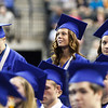 Graduate Taylor Suzanne Kincer (center) smiles as her row is being called during commencement at Sears Centre in Hoffman Estates, IL on Sunday, May 26, 2013 (Sean King for Shaw Media)