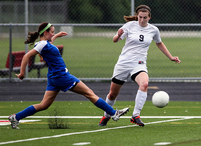 Sarah Nader - snader@shawmedia.com Lake Forest's Dani Loeger (left) tries to steal the ball from Prairie Ridge's Kelsey Bear during the first half of Tuesday's IHSA Class 2A Barrington Supersectional in Barrington May 28, 2013. Prairie Ridge won, 1-0.