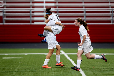 Sarah Nader - snader@shawmedia.com Prairie Ridge's Larissa Dooley (center) jumped in a teammates arms after scoring during the second half of Tuesday's IHSA Class 2A Barrington Supersectional against Lake Forest in Barrington May 28, 2013. Prairie Ridge won, 1-0.