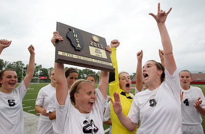 Sarah Nader - snader@shawmedia.com Prairie Ridge's Becca Hoklas carries the teams supersectional plaque after the team won Tuesday's IHSA Class 2A Barrington Supersectional against Lake Forest in Barrington May 28, 2013. Prairie Ridge won, 1-0.