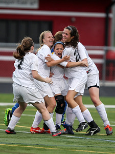 Sarah Nader - snader@shawmedia.com The team crowds around Prairie Ridge's Larissa Dooley (center) after she scored during the second half of Tuesday's IHSA Class 2A Barrington Supersectional against Lake Forest in Barrington May 28, 2013. Prairie Ridge won, 1-0.