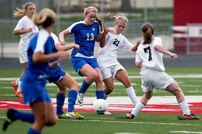 Sarah Nader - snader@shawmedia.com Lake Forest's Brooke Green (left) and Prairie Ridge's  Ali Fanning fight for control of the ball during the first half of Tuesday's IHSA Class 2A Barrington Supersectional in Barrington May 28, 2013. Prairie Ridge won, 1-0.