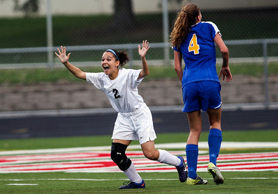 Sarah Nader - snader@shawmedia.com Prairie Ridge's Larissa Dooley celebrates after scoring Prairie Ridges only goal during the second half of Tuesday's IHSA Class 2A Barrington Supersectional against Lake Forest in Barrington May 28, 2013. Prairie Ridge won, 1-0.