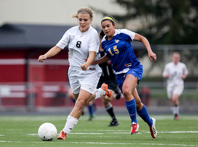 Sarah Nader - snader@shawmedia.com Prairie Ridge's Jordan Reitz (left) is guarded by Lake Forest's Adrian Walker during the first half of Tuesday's IHSA Class 2A Barrington Supersectional in Barrington May 28, 2013. Prairie Ridge won, 1-0.