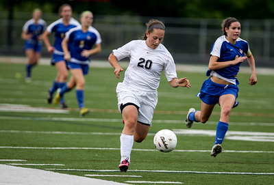 Sarah Nader - snader@shawmedia.com Prairie Ridge's Erin Ginsberg (center) brings the ball down field during the second half of Tuesday's IHSA Class 2A Barrington Supersectional against Lake Forest in Barrington May 28, 2013. Prairie Ridge won, 1-0.