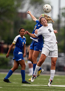 Sarah Nader - snader@shawmedia.com Lake Forest's Paige Bourne (left) and Prairie Ridge's Cassie Warton head the ball during the second half of Tuesday's IHSA Class 2A Barrington Supersectional in Barrington May 28, 2013. Prairie Ridge won, 1-0.