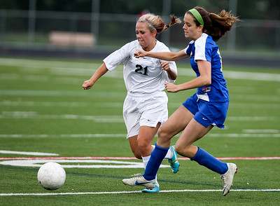 Sarah Nader - snader@shawmedia.com Praire Ridge's Ali Fanning (left) and Lake Forest's Mackenzie Mick fight for control of the ball during the second half of Tuesday's IHSA Class 2A Barrington Supersectional  in Barrington May 28, 2013. Prairie Ridge won, 1-0.