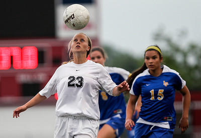 Sarah Nader - snader@shawmedia.com Prairie Ridge's Becca Hoklas (left) heads the ball during the first half of Tuesday's IHSA Class 2A Barrington Supersectional against Lake Forest in Barrington May 28, 2013. Prairie Ridge won, 1-0.