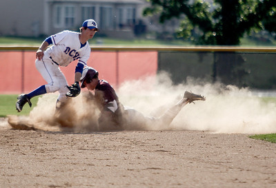 Sarah Nader - snader@shawmedia.com Dundee-Crown's Garrett Ryan 9left) waits for the pass while Prairie Ridge's Will Harvel safely slides to second  during the second inning of Wednesday's Class 4A Huntley Sectional baseball semifinal on May 29, 2013. Dundee-Crown won, 15-4.