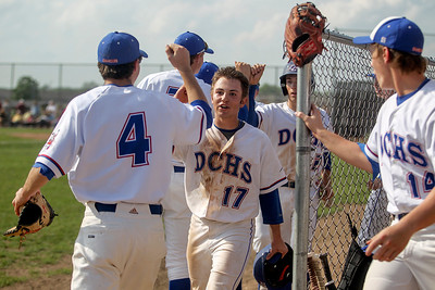 Sarah Nader - snader@shawmedia.com Dundee-Crown's Zach Girard (center) celebrates with his team after scoring a run during the second inning of Wednesday's Class 4A Huntley Sectional baseball semifinal against Prairie Ridge on May 29, 2013. Dundee-Crown won, 15-4.