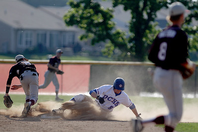 Sarah Nader - snader@shawmedia.com Prairie Ridge's Danny Pecoraro (left) throws to first as Dundee-Crown's Ryan Suwanski slides to second during the third inning of Wednesday's Class 4A Huntley Sectional baseball semifinal on May 29, 2013. Dundee-Crown won, 15-4.