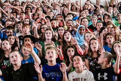 "Lathan Goumas - lgoumas@shawmedia.com Students at Conley Elementary School sings-a-long to ""Home"" by Phillip Phillips as As fifth-grade teacher Ryan Hart lip synchs a performance of the song during a ""concert"" put on by faculty and staff in the school gym in Algonquin, Ill. on Wednesday, May 29, 2013. The concert, which featured faculty and staff lip syncing to famous songs, was a reward to students for reaching their fundraising goal in the Principal's Challenge."