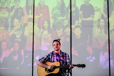 "Lathan Goumas - lgoumas@shawmedia.com Conley Elementary School fifth-grade teacher Ryan Hart lip syncs to ""Home"" as he performs as Phillip Phillips during a ""concert"" put on by faculty and staff in the school gym in Algonquin, Ill. on Wednesday, May 29, 2013.  The concert, which featured faculty and staff lip syncing to famous songs, was a reward to students for reaching their fundraising goal in the Principal's Challenge."