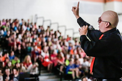 """Lathan Goumas - lgoumas@shawmedia.com Conley Elementary School assistant principal Ed Garza lip syncs to """"Don't Stop the Party"""" as he performs as Pitbull during a """"concert"""" put on by faculty and staff in the school gym in Algonquin, Ill. on Wednesday, May 29, 2013.  The concert, which featured faculty and staff lip syncing to famous songs, was a reward to students for reaching their fundraising goal in the Principal's Challenge."""