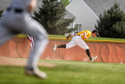 Sarah Nader - snader@shawmedia.com Jacobs' Matt Hickey dives for the ball during the second inning of Thursday's IHSA Class 4A Baseball Sectional Tournament against Hononegah in Huntley on May 31, 2013. Jacobs' defeated Hononegah,  3-2.