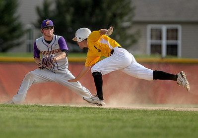 Sarah Nader - snader@shawmedia.com Hononegah's Kellen McCormick (left) waits for Jacobs' Jon Berndt as he slides to second base during the third inning of Thursday's IHSA Class 4A Baseball Sectional Tournament in Huntley on May 31, 2013. Jacobs' defeated Hononegah, 3-2.