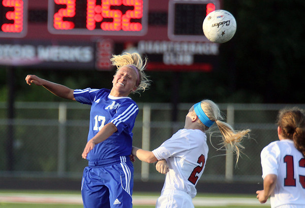 Jeff Krage – For Shaw Media<br /> St. Charles North's Kelly Manski heads the ball during Wednesday's IHSA class 3A super-sectional against Barrington at Barrington High School.<br /> Barrington 5/29/13