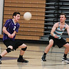 Senior Nic Cook volleys the ball as senior Pat Misiewicz prepares for the pass during the St. Charles North boy's volleyball practice Thursday at the St. Charles North gymnasium.