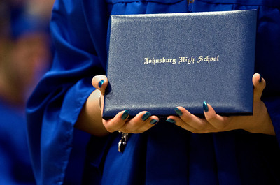 Brett Moist/ for the Northwest Herald  Graduates showoff their diploma jackets during the Johnsburg High school commencement on Friday.