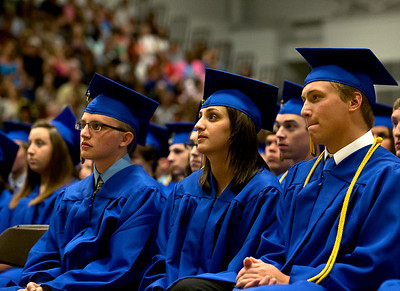Brett Moist/ from the Northwest Herald  (from left to right) Brian Anderson, Lissie Alkazoff, and Cameron Adams listen to the speeches of their fellow graduates during the Johnsburg High school commencement on Friday.