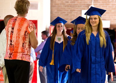 Brett Moist/ for the Northwest Herald  Erika Kosick leads a group of students to the gym to begin the Johnsburg High School Commencement on Friday.