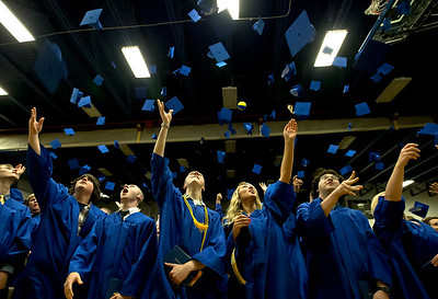 Brett Moist/ for the Northwest Herald  Johnsburg graduates throw their caps up high to celebrate their completion of high school during the Johnsburg High school commencement on Friday.