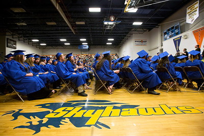 Brett Moist/ for the Northwest Herald  Graduates wait to be called up for their diplomas during the Johnsburg High school commencement on Friday.