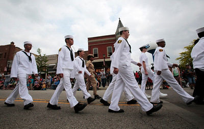 Kyle Grillot - kgrillot@shawmedia.com   The U.S. Naval Sea Cadets march down Ayers St. during the 72nd annual Milk Day parade in in downtown Harvard on Saturday, June 1, 2013.