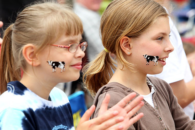 Kyle Grillot - kgrillot@shawmedia.com   Katrina Prokuski, 10, and Alexis Lehmann, 10, watch as the 72nd annual Milk Day parade begins in in downtown Harvard on Saturday, June 1, 2013.