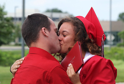Kyle Grillot - kgrillot@shawmedia.com   David Crump kisses graduate Alexandra Beaudette after the Huntley High School commencement at the Sears Center Arena on Saturday, June 1, 2013.