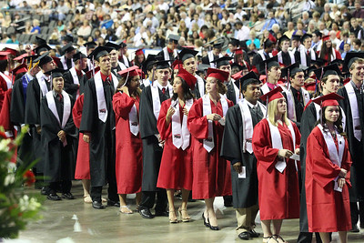 Kyle Grillot - kgrillot@shawmedia.com   Graduates wait in line to receive their diplomas during the Huntley High School commencement at the Sears Center Arena on Saturday, June 1, 2013.