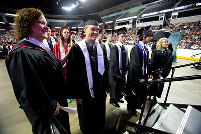 Kyle Grillot - kgrillot@shawmedia.com   Counselor Angie Daurer assists William McFall before he enters the stage during the Huntley High School commencement at the Sears Center Arena on Saturday, June 1, 2013.