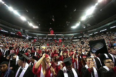 Kyle Grillot - kgrillot@shawmedia.com   Graduates throw their caps after  the Huntley High School commencement at the Sears Center Arena on Saturday, June 1, 2013.