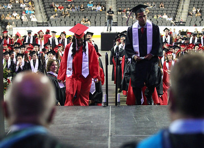 Kyle Grillot - kgrillot@shawmedia.com   Graduates enter the stage to receive their diplomas during the Huntley High School commencement at the Sears Center Arena on Saturday, June 1, 2013.