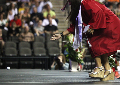 Kyle Grillot - kgrillot@shawmedia.com   Graduate Sydney Wieczorek throws a golf ball to principal David Johnson in recognition of his last year at Huntley during the Huntley High School commencement at the Sears Center Arena on Saturday, June 1, 2013.