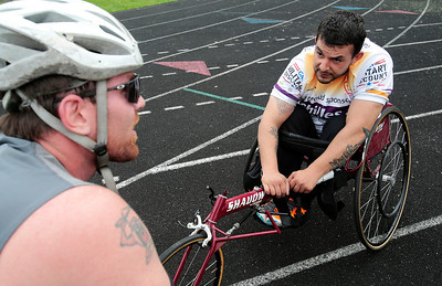 Kyle Grillot - kgrillot@shawmedia.com   Bob Swanson talks with Marine Corps veteran Al Velasco after competing in the 1500-meter race during the sixth annual Run and Roll Track Meet, a Paralympic Experience at McHenry High School's McCracken Field on Saturday, June 1, 2013. This is the last event in the area to qualify for the National Junior Disability Championships in Rochester, Minnesota.