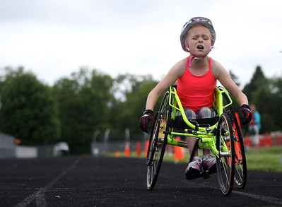 Kyle Grillot - kgrillot@shawmedia.com   Sarah Bolton, 9, competes in the 60-meter dash during the sixth annual Run and Roll Track Meet, a Paralympic Experience at McHenry High School's McCracken Field on Saturday, June 1, 2013. This is the last event in the area to qualify for the National Junior Disability Championships in Rochester, Minnesota.