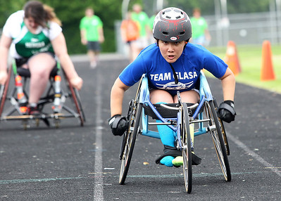 Kyle Grillot - kgrillot@shawmedia.com   Evelyn Felipex, 15, competes in the 100-meter dash during the sixth annual Run and Roll Track Meet, a Paralympic Experience at McHenry High School's McCracken Field on Saturday, June 1, 2013. This is the last event in the area to qualify for the National Junior Disability Championships in Rochester, Minnesota.