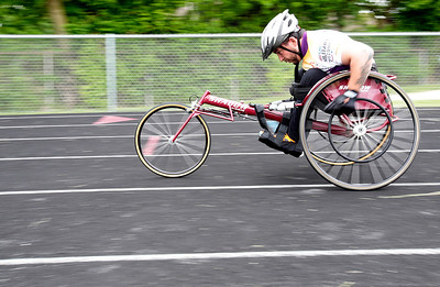 Kyle Grillot - kgrillot@shawmedia.com   Marine Corps veteran Al Velasco competes in the 1500-meter race during the sixth annual Run and Roll Track Meet, a Paralympic Experience at McHenry High School's McCracken Field on Saturday, June 1, 2013. This is the last event in the area to qualify for the National Junior Disability Championships in Rochester, Minnesota.