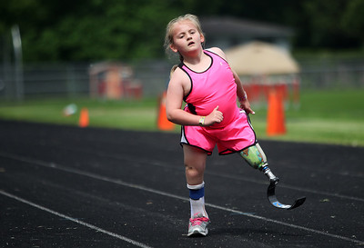 Kyle Grillot - kgrillot@shawmedia.com   Amanda Becker, 8, competes in the 60-meter dash of the sixth annual Run and Roll Track Meet, a Paralympic Experience at McHenry High School's McCracken Field on Saturday, June 1, 2013. This is the last event in the area to qualify for the National Junior Disability Championships in Rochester, Minnesota.\