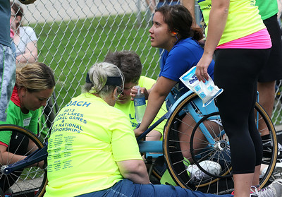 Kyle Grillot - kgrillot@shawmedia.com   Evelyn Felipex, 15, is helped by Great Lakes Adaptive Sports Association coaches after an injury sustained while  competing in the sixth annual Run and Roll Track Meet, a Paralympic Experience at McHenry High School's McCracken Field on Saturday, June 1, 2013. This is the last event in the area to qualify for the National Junior Disability Championships in Rochester, Minnesota.